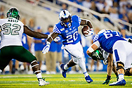 Kentucky Wildcats running back Kavosiey Smoke (20) runs the ball upfield in the first half against Eastern Michigan at Kroger Field in Lexington, Ky., Saturday, Sept. 7, 2019.