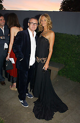 DAMIEN HIRST and ELLE MACPHERSON at the Serpentine Gallery Summer party sponsored by Yves Saint Laurent held at the Serpentine Gallery, Kensington Gardens, London W2 on 11th July 2006.<br />
