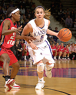 Kansas State's Shalee Lehning (5), drives around pressure from Fresno State's Mirenda Swearengin (L), during the second half at Bramlage Coliseum in Manhattan, Kansas, March 22, 2006.  K-State defeated the Bulldogs 64-61 in the second round of the WNIT.
