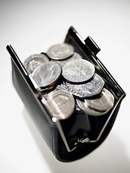Dec. 14, 2012 - Purse full of coins (Credit Image: © Image Source/ZUMAPRESS.com)