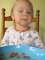 Ninteen month old toddler Talus Book clowns while eating