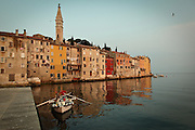Early morning a crew of workers cleans local seawall from barnacles - town of Rovinj in northern Croatia