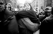 Father surrounded by police hugging daughter, Reclaim the Streets London, Trafalgar Square, April 1997