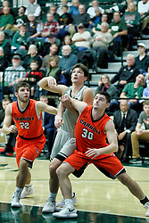 BLOOMINGTON, IL - December 15: Tarren Hall, Matthew Leritz and Anthony Marlowe during a college basketball game between the IWU Titans  and the Carroll Pioneers on December 15 2018 at Shirk Center in Bloomington, IL. (Photo by Alan Look)