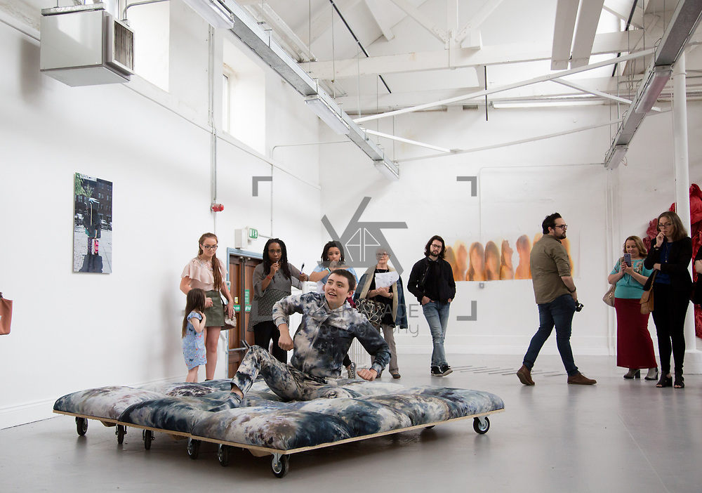 11.06.2017         <br /> International award winning artists are among the almost 200 graduates of Limerick School of Art and Design who's work went on exhibition at the LSAD Graduate Show 2017.<br /> <br /> Pictured is 4th year graduating Sculpture and Combined Media  student, Isolde Donohoe performing her work titled 'Newly Planted Girl'.<br />  <br /> Students from the college took control of the over-riding message of this historical show as they conceptualised, designed and delivered on the theme - be.cause.<br />  <br /> The hypothesis conceived by Graphic Design graduates Cassandra Walsh and David Reilly, is derived from the fact the graduates have now reached a stage where they are confident with their work, their interpretations and creative solutions. As creative minds they have an innate need to &ldquo;do&rdquo; something. There is just this need to create, be.cause.<br /> . Picture: Alan Place.