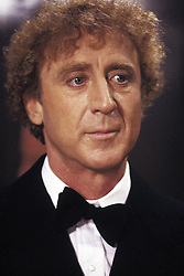 GENE WILDER, (born Jerome Silberman, June 11, 1933 - August 28, 2016) was an American stage and screen comic actor, screenwriter, film director, and author. He was known best for the lead role in the 1971 film 'Willy Wonka in Willy Wonka & the Chocolate Factory,' and the Mel Brooks comedies 'Blazing Saddles', and 'Young Frankenstein', which Wilder co-wrote, garnering the pair an Academy Award nomination for Best Adapted Screenplay. Wilder died at age 83 from complications from Alzheimer's disease. PICTURED: GENE WILDER in a scene from the 1986 film 'Haunted Honeymoon.' (Credit Image: © Orion Pictures/Entertainment Pictures/ZUMAPRESS.com)
