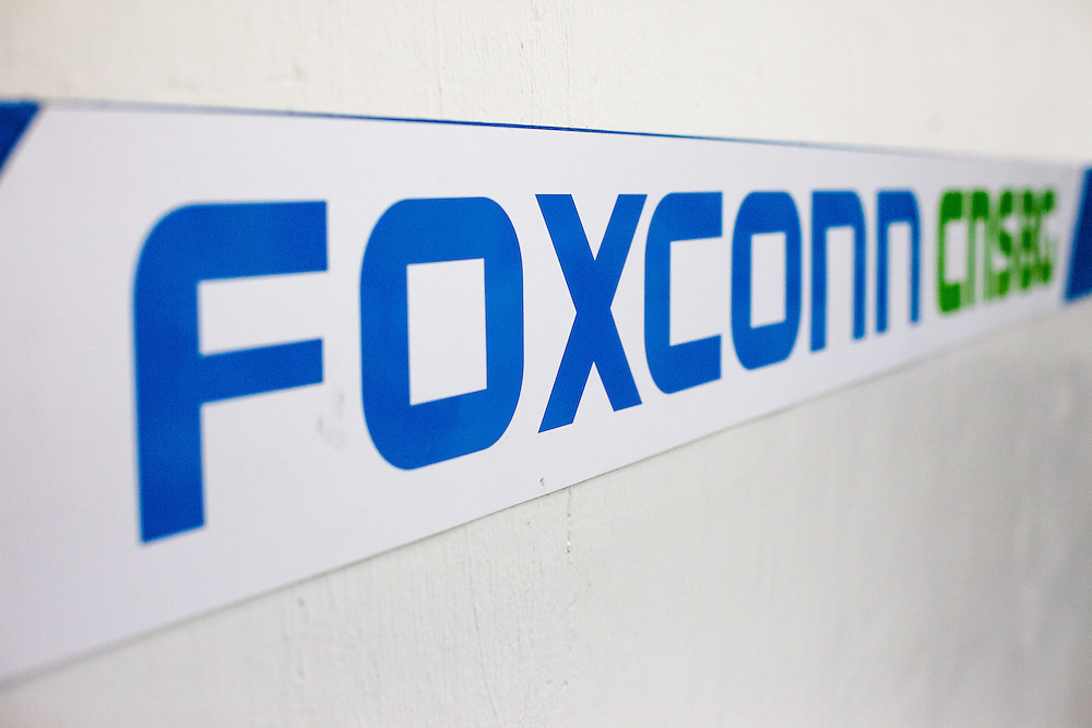 Foxconn logo at the Foxconn branch in Pardubice, Czech Republic. Foxconn Technology Group, is a multinational electronics contract manufacturing company headquartered in New Taipei, Taiwan. Foxconn is the world's largest electronics contractor manufacturer, and the third-largest information technology company by revenue.