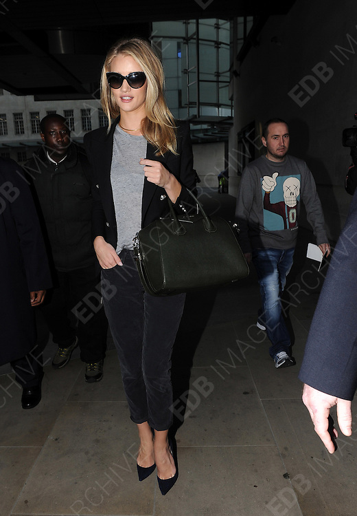 17.OCTOBER.2013. LONDON<br /> <br /> (CODE EBDB)<br /> ROSIE HUNTINGTON WHITELEY LEAVING BBC RADIO ONE, LONDON<br /> <br /> BYLINE: EDBIMAGEARCHIVE.CO.UK<br /> <br /> *THIS IMAGE IS STRICTLY FOR UK NEWSPAPERS AND MAGAZINES ONLY*<br /> *FOR WORLD WIDE SALES AND WEB USE PLEASE CONTACT EDBIMAGEARCHIVE - 0208 954 5968*