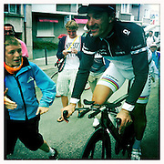 A boy reaches for a high five from Fabian Cancellara - 2011 Tour de France - Stage 20 Time Trial - Grenoble, France