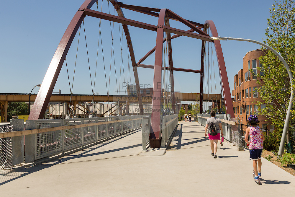 Walkers at the Milwaukee Avenue bridge on the 606 elevated bike trail, green space and park built on the old Bloomingdale Line in the Logan Square neighborhood of Chicago, Illinois, USA