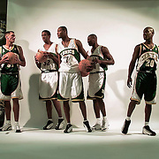 Brent Barry, Calvin Booth, Rashard Lewis, Desmond Lewis and Gary Payton model the new Sonics uniforms during a media day on October 1, 2001 in Seattle, Washington.