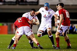 Kai Owen of England U20 is tackled by Dewi Lake of Wales U20 - Mandatory by-line: Robbie Stephenson/JMP - 22/02/2019 - RUGBY - Zip World Stadium - Colwyn Bay, Wales - Wales U20 v England U20 - Under-20 Six Nations