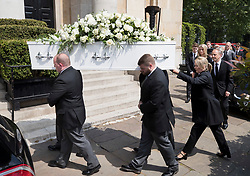 © Licensed to London News Pictures. 22/05/2018. London, UK. Family and friends  of television presenter Dale Winton follow his coffin as it is carried into Commonwealth Church in Marylebone, London. Dale Winton, who was found dead at his home on April 18, was famous for presenting Supermarket Sweep and National Lottery game show. Photo credit: Peter Macdiarmid/LNP