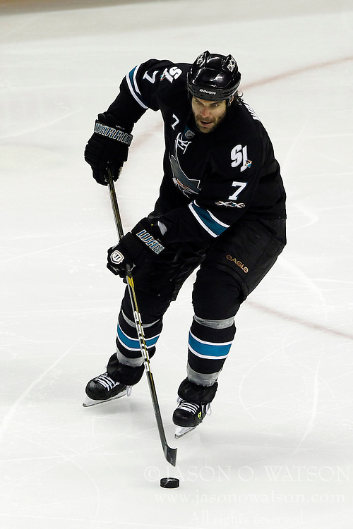 April 14, 2011; San Jose, CA, USA;  San Jose Sharks defenseman Niclas Wallin (7) skates with the puck against the Los Angeles Kings during the overtime period at HP Pavilion. San Jose defeated Los Angeles 3-2 in overtime. Mandatory Credit: Jason O. Watson / US PRESSWIRE