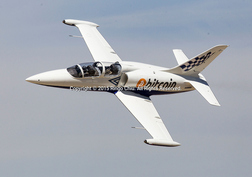 A L-39 Albatross Bitcoin Jet performs during Los Angeles County Air Show, in Lancaster, California on March 21, 2015. (Photo by Ringo Chiu/PHOTOFORMULA.com)
