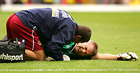 Photo: Frances Leader.<br /> Watford v Burnley. Coca Cola Championship.<br /> 20/08/2005.<br /> <br /> Burnley's Goal Keeper Brian Jensen lies on the floor injured while Watford's Matthew Spring scores the third goal of the game for Watford.