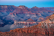 Dusk twilight at Mather Point Overlook, Grand Canyon National Park, Arizona, USA. Starting at least 5 to 17 million years ago, erosion by the Colorado River has exposed a column of distinctive rock layers, which date back nearly two billion years at the base of Grand Canyon. While the Colorado Plateau was uplifted by tectonic forces, the Colorado River and tributaries carved Grand Canyon over a mile deep (6000 feet), 277 miles  long and up to 18 miles wide.