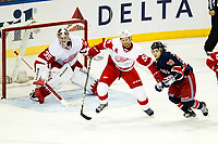 March 09, 2014: Detroit Red Wings Defenceman Niklas Kronwall (55) 2193 shoves New York Rangers Right Wing Mats Zuccarello (36) 7214 in front of the Red Wings net during a regular season NHL Eishockey Herren USA game between the Detroit Red Wings and the New York Rangers at Madison Square Garden in New York, NY. New York Rangers goalie Henrik Lundqvist collects his 49th career shut out which ties the franchise record as the Blueshirts defeat the Red Wings 3-0. NHL Eishockey Herren USA MAR 09 Red Wings at Rangers <br />