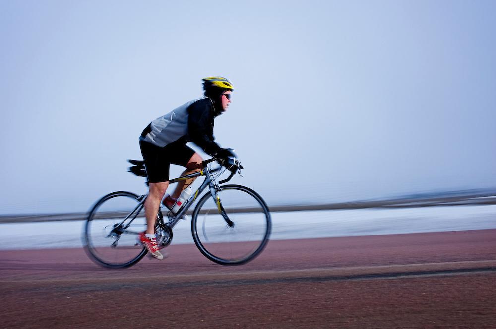 Dan Letche biking in rain and fog South of Vermillion, SD on March 10, 2010..