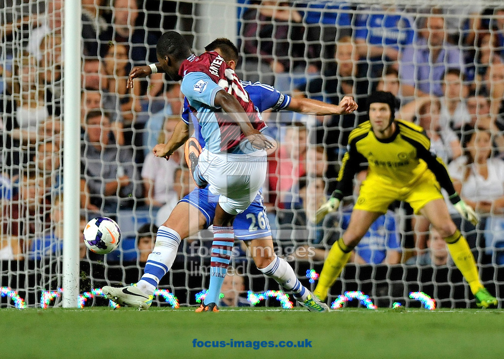 Picture by Alan Stanford/Focus Images Ltd +44 7915 056117<br /> 21/08/2013<br /> Christian Benteke of Aston Villa gets the equaliser during the Barclays Premier League match at Stamford Bridge, London.