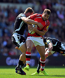 Olly Barkley (London Welsh) is tackled in possession - Photo mandatory by-line: Patrick Khachfe/JMP - Mobile: 07966 386802 06/09/2014 - SPORT - RUGBY UNION - Oxford - Kassam Stadium - London Welsh v Exeter Chiefs - Aviva Premiership