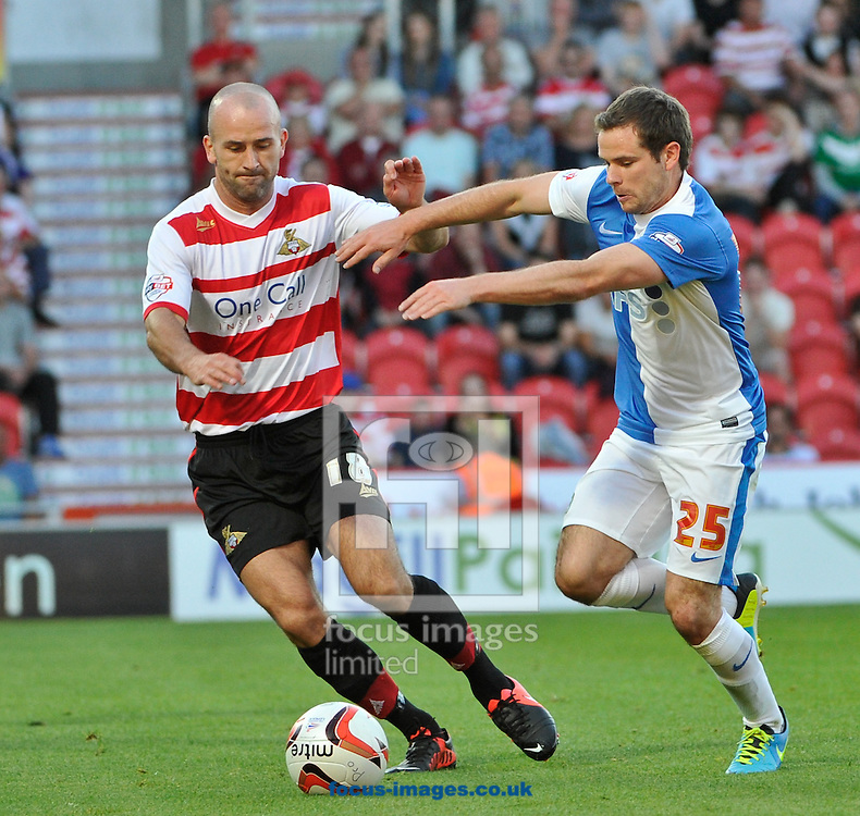 Picture by Richard Land/Focus Images Ltd +44 7713 507003<br /> 16/08/2013<br /> Paul Keegan of Doncaster Rovers and Alan Judge of Blackburn Rovers during the Sky Bet Championship match at the Keepmoat Stadium, Doncaster.