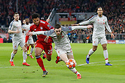 Liverpool defender Andrew Robertson (26) does his best to hold off Bayern Munich midfielder Serge Gnabry (22) during the Champions League match between Bayern Munich and Liverpool at the Allianz Arena, Munich, Germany, on 13 March 2019.