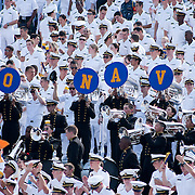Navy marching in the stands Saturday Sept. 3, 2011 at Marine Corps Memorial Stadium in Annapolis Maryland.<br /> <br /> Navy would go on to defeat Delaware 40-17 Navy leads the all-time series against the Blue Hens, 9-7, including a 35-18 victory in 2009 when quarterback Ricky Dobbs rushed for five touchdowns.<br /> <br /> Navy will hit road for a show down with Western Kentucky next Saturday Sept. 10, 2011 in Bowling Green, Ky.