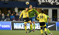 March 1, 2018 - Seattle, Washington, U.S - Soccer 2018: Seattle's CHAD MARSHALL (14) and LIBER QUINONES (14) battle for the ball as Santa Tecla FC visits the Seattle Sounders for a CONCACAF match at Century Link Field in Seattle, WA. (Credit Image: © Jeff Halstead via ZUMA Wire)