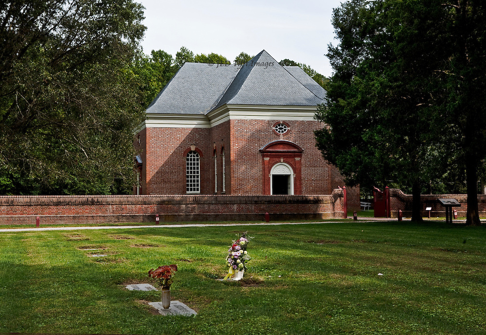 "Perfect American Georgian brick church, funded by Robert ""King"" Carter in 1735.  Central plan, carved walnut pews and pulpit.  Carfully preserved and devotedly maintained by a private organization.  Seen from the southeast across the graveyard, two honored with fresh flower bouquets."