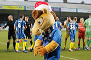Gillingham mascot Tommy Trueblue looking festive with his Santa hat as players shake hands before the EFL Sky Bet League 1 match between Gillingham and Wycombe Wanderers at the MEMS Priestfield Stadium, Gillingham, England on 15 December 2018.