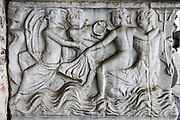 Roman period carved stone relief sarcophagus panel inside the Camposanto Monumentale cemetery. Pisa, Tuscany, Italy.