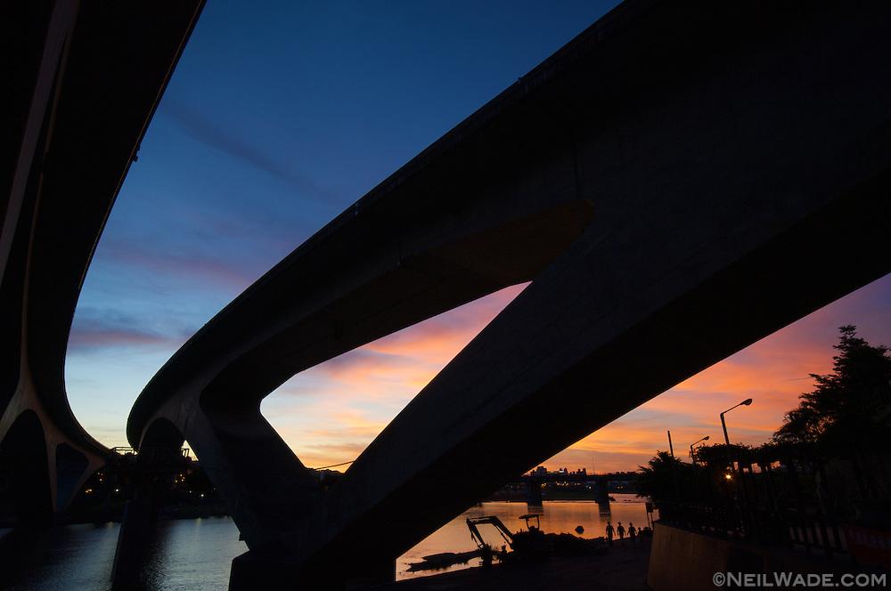 Sunset on a curved bridge in Taipei, Taiwan.