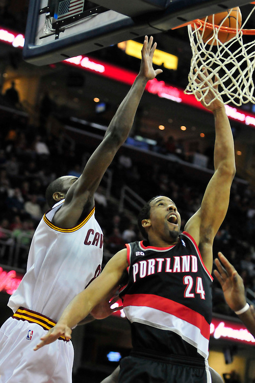 Feb. 5, 2011; Cleveland, OH, USA; Portland Trail Blazers point guard Andre Miller (24) drives to the basket past Cleveland Cavaliers guard Christian Eyenga (8) during the first quarter at Quicken Loans Arena. Mandatory Credit: Jason Miller-US PRESSWIRE