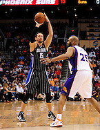 Mar. 13, 2011; Phoenix, AZ, USA; Orlando Magic forward Hedo Turkoglu (15) makes a pass over the Phoenix Suns guard Vince Carter (25) at the US Airways Center. Mandatory Credit: Jennifer Stewart-US PRESSWIRE