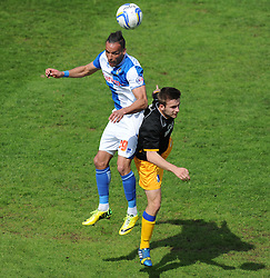 Bristol Rovers' Kaid Mohamed battles for a high ball with Mansfield Town's Godfrey Poku - Photo mandatory by-line: Alex James/JMP - Mobile: 07966 386802 03/05/2014 - SPORT - FOOTBALL - Bristol - Memorial Stadium - Bristol Rovers v Mansfield - Sky Bet League Two