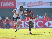 USA player Danny Barrett tries to fend off a  during the Emirates Dubai rugby sevens match between USA  and Kenya at the Sevens Stadium, Al Ain Road, United Arab Emirates on 3 December 2016. Photo by Ian  Muir.*** during the Emirates Dubai rugby sevens match between *** and *** at the Sevens Stadium, Al Ain Road, United Arab Emirates on 3 December 2016. Photo by Ian  Muir.