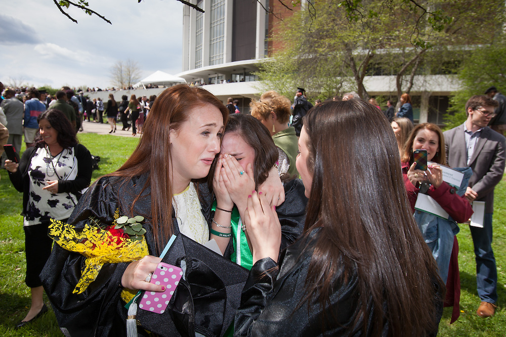 Arielle Busch, center is consoled by her friends Natalie Taylor, left and Jamie Collins.  Photo by Ohio University / Jonathan Adams