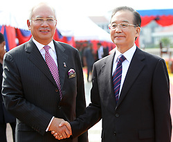 © licensed to London News Pictures. KUALA LUMPUR 28/04/11. Chinese Premier Wen Jiabao (R) shakes hand with the Malaysian prime minister Najib Razak at the prime minister's office in Putrajaya outside Kuala Lumpur on April 28, 2011.Wen began a two-day visit to Malaysia to reaffirm relations and boost economic ties between the two countries. Please see special instructions for usage rates. Photo credit should read Mohd Rasfan/LNP