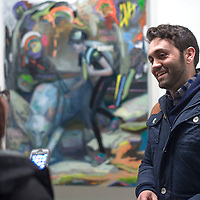 """Artist Corey Lamb mingles with guests at the opening of his show """"Cold Comfort"""" at the University of New Mexico Gallup Branch Tuesday. Lamb is currently an Associate Instructor of  digital media at Indiana University."""