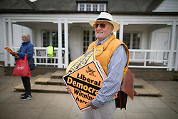 © Licensed to London News Pictures. 28/04/2017. London, UK. A Liberal Democrat supporter stands on Twickenham Green with placards as Vince Cable launches his election campaign in a bid to return to Parliament.  Photo credit: Peter Macdiarmid/LNP