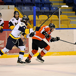 WHITBY, ON - Feb 11: Ontario Junior Hockey League game between Orangeville Flyers and Whitby Fury. Peter Stepanis #12 of the Orangeville Flyers Hockey Club skates with the puck while being pursued by Connor Hale 7 of the Whitby Fury Hockey Club during first period game action.<br /> (Photo by Shawn Muir / OJHL Images)