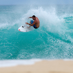 Pro surfer, Taylor Knox free surfing at backdoor on Oahu's North Shore.