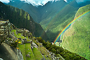 PERU, MACHU PICCHU: Double rainbow over the ancient Inca terraces of Machu Picchu with Urubamba mountains and valley in the background. Machu Picchu is a pre-Columbian Inca site located 2,430 metres (8,000 ft) above sea level. It was built around 1460 AD but was abandoned as an official site for the Inca rulers a hundred years later, at the time of the Spanish conquest of the Inca Empire.