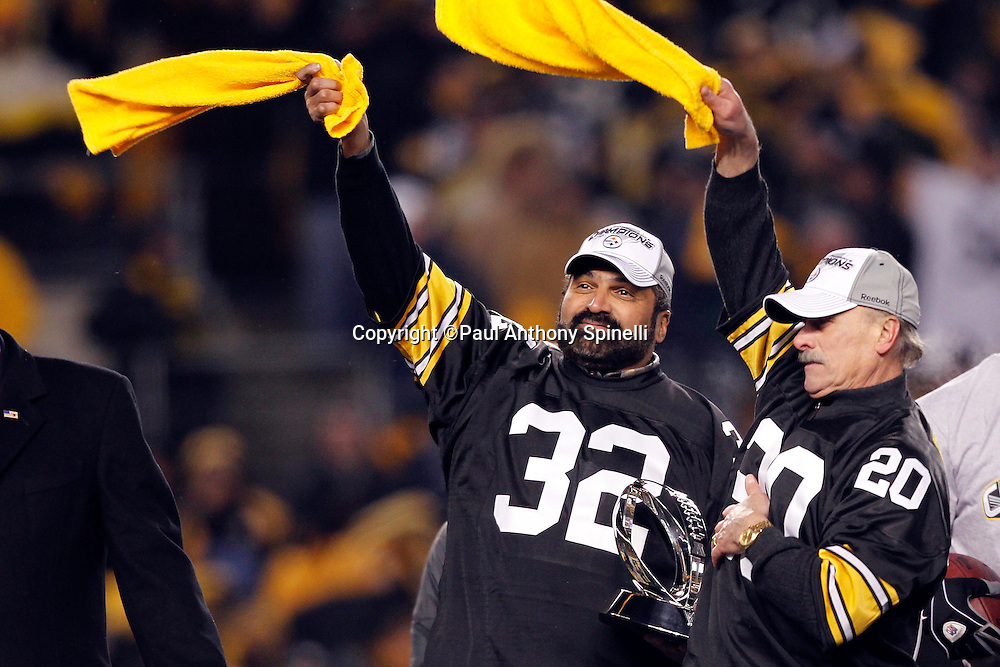 Former Pittsburgh Steelers running back Franco Harris (left) and former Pittsburgh Steelers halfback Rocky Bleier wave terrible towels during the postgame trophy presentation at the NFL 2011 AFC Championship playoff football game against the New York Jets on Sunday, January 23, 2011 in Pittsburgh, Pennsylvania. The Steelers won the game 24-19. (©Paul Anthony Spinelli)