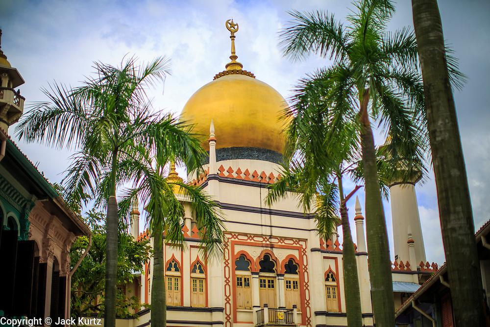 17 DECEMBER 2012 - SINGAPORE, SINGAPORE: The Sultan Mosque or Sultan Masjid in Singapore. The Sultan Mosque is the focal point of the historic Kampong Glam area of Singapore. Also known as Masjid Sultan, it was named for Sultan Hussein Shah. The mosque was originally built in the 1820s. The original structure was demolished in 1924 to make way for the current building, which was completed in 1928. The mosque holds great significance for the Muslim community, and is considered the national mosque of Singapore. It was designated a national monument in 1975.     PHOTO BY JACK KURTZ