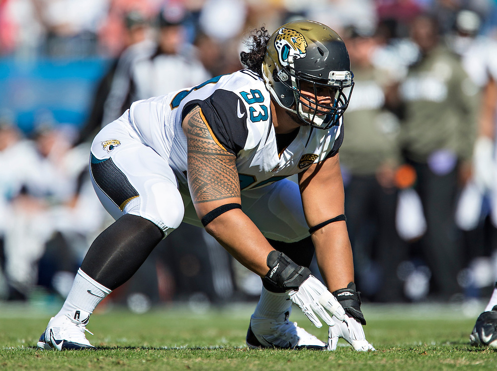 NASHVILLE, TN - NOVEMBER 10:  Tyson Alualu #93 of the Jacksonville Jaguars on the field during a play against the Tennessee Titans at LP Field on November 10, 2013 in Nashville, Tennessee.  The Jaguars defeated the Titans 29-27.  (Photo by Wesley Hitt/Getty Images) *** Local Caption *** Tyson Alualu