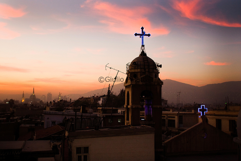 Saint George church and in the background the  Omayyadi mosque which used to be a Cathedral. Damascus
