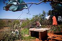 CAETITE, BRAZIL - OCTOBER 25, 2013:<br /> Maria da Silva, and her husband's family agreed to be paid $250 a month to permit Renova Energia with wind turbines on their 46-acre land. A string of wind-turbine parks, in the municipal of Caetite, are being erected in the windiest stretches of Bahia state, Brazil, on Friday, Oct 25, 2013. <br /> (Photo by Lianne Milton/For The Washington Post