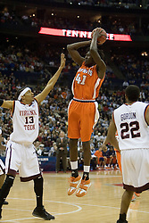 Illinois Fighting Illini forward Warren Carter (41) shoots over Virginia Tech Hokies forward Deron Washington (13).  The #5 seed Virginia Tech Hokies defeated the #12 seed Illinois Illini 54-52 in the first round of the Men's NCAA Tournament in Columbus, OH on March 16, 2007.